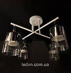 Стельова люстра біла на 4 лампи з поворотними плафонами