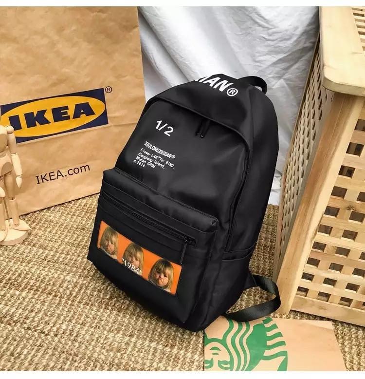 Молодежный рюкзак с надписями водоотталкивающий черный.