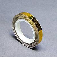 Фольга на липкой основе фигурная в рулоне. золото