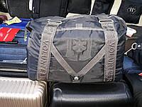 Спортивно-дорожная сумка на подкладке внутри, изготовлена из новой, прочной непромокаемой ткани, черная