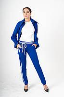 Брюки женские зауженные синие с асимметричным белым декором и накладным карманом