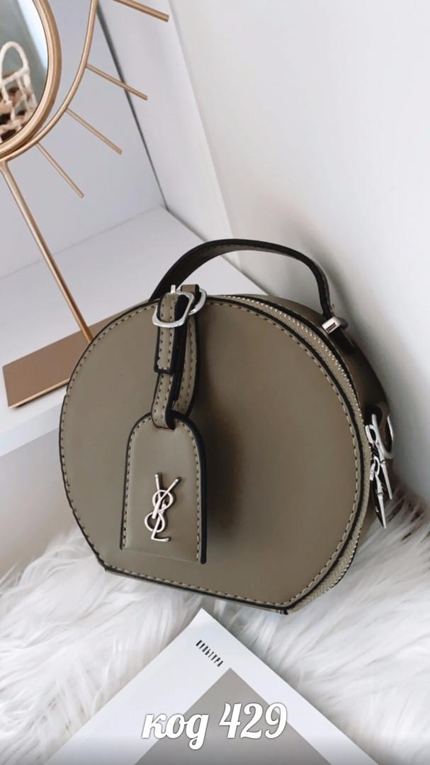 Круглая зеленая сумка из эко-кожи