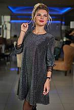 Короткое нарядное платье с люрексом декорировано сеткой на рукавах  (48-50, 50-52). Черное