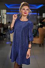 Короткое нарядное платье с люрексом декорировано сеткой на рукавах  (48-50, 50-52). Синее