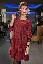 Короткое нарядное платье с люрексом декорировано сеткой на рукавах  (48-50, 50-52). Красное