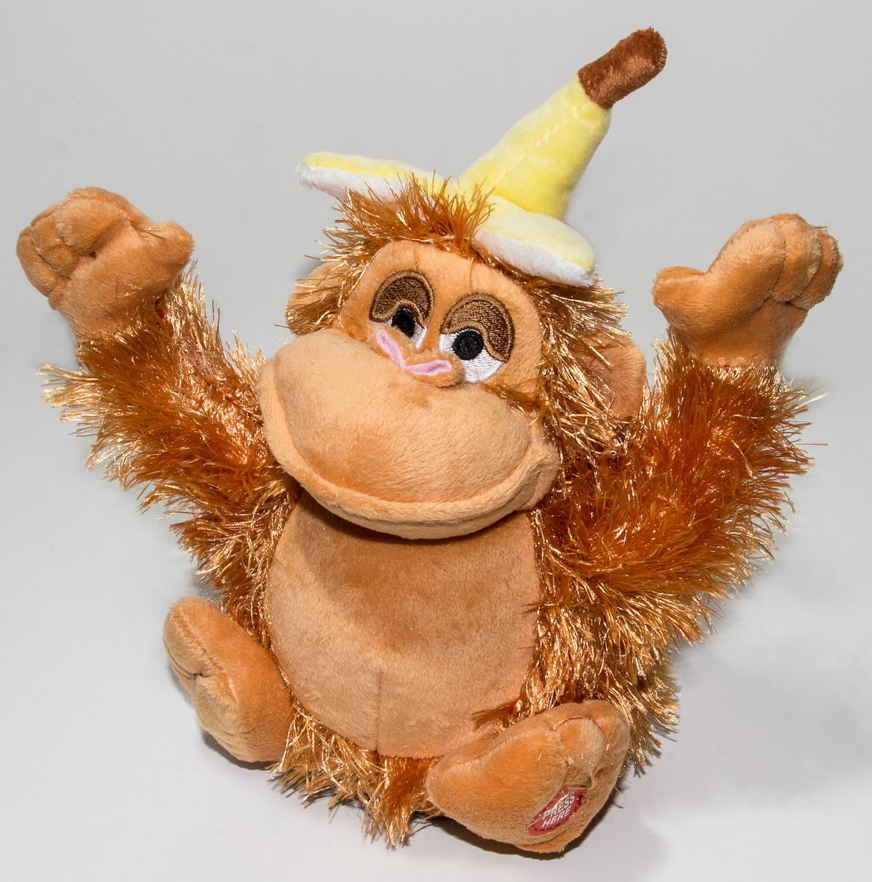 Интерактивная игрушка, танцующая и поющая обезьяна.