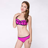 Женский раздельный купальник ярко-розового цвета с черной окантовкой. Наличие размеров смотрите в описании.