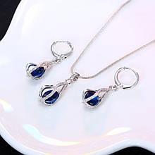 Ювелірний комплект прикрас сережки і ланцюжок з кулоном з синіми каменями код 1316