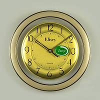Небольшие кварцевые часы на стену 28х4 см.