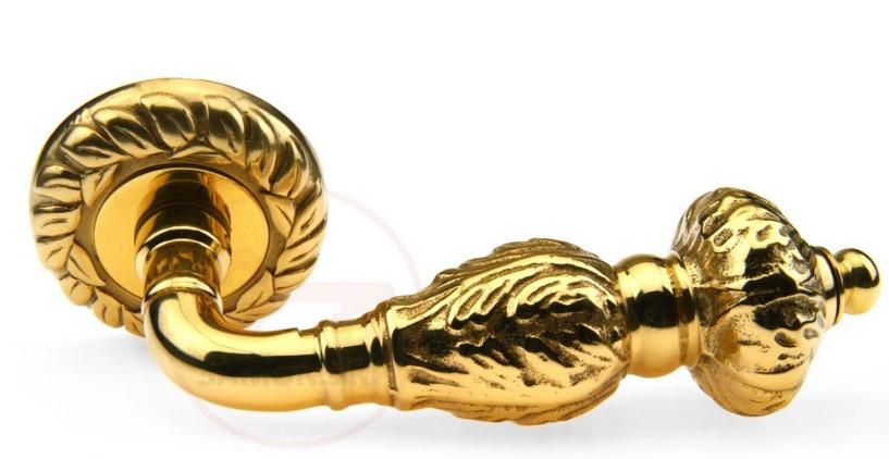 Дверная ручка на круглой розетке Fadex Gemini латунь полированная (Италия)