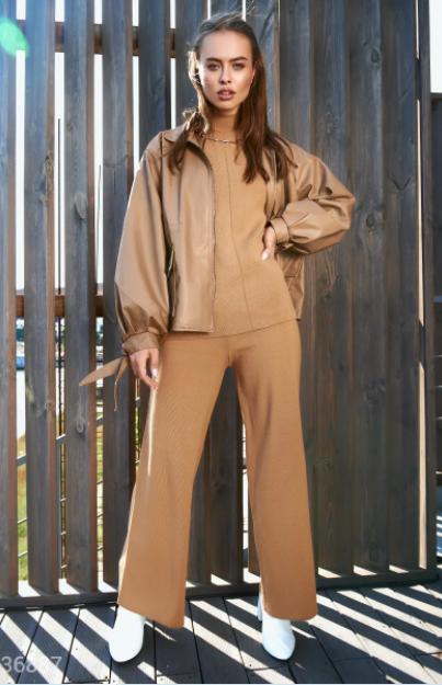 Кожаная куртка с объемными рукавами UN