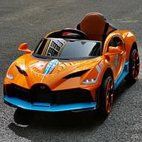 """Детский электромобиль Tilly """"Bugatti"""" музыкальный T-7657 EVA ORANGE с пультом управления 122*70*50"""