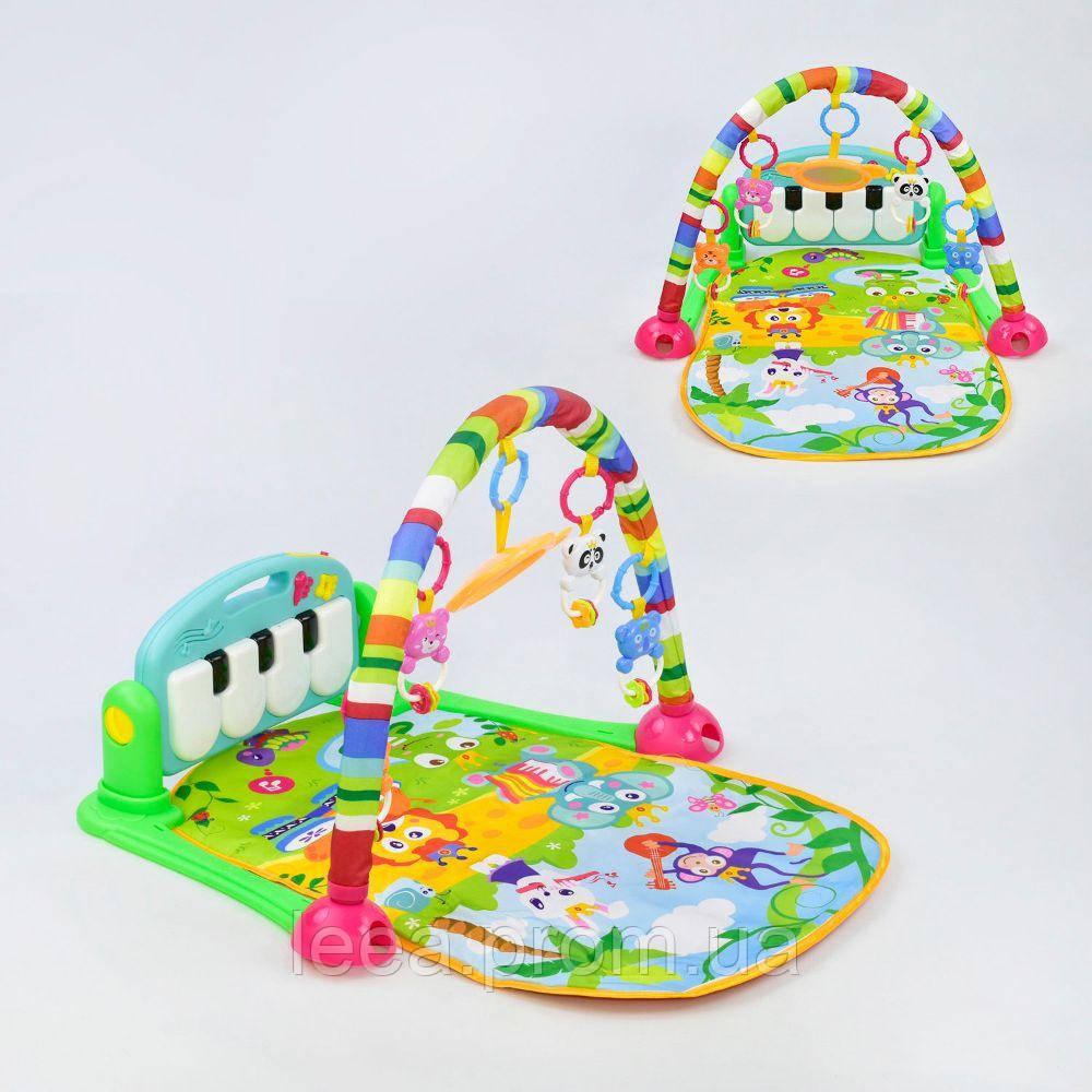 Многофункциональный детский музыкальный коврик HE 0604 с пианино и подвесными игрушками зеленый