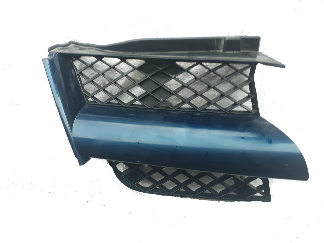 Решетка бампера передняя правая Mitsubishi Outlander '07- (Tempest) MN133230
