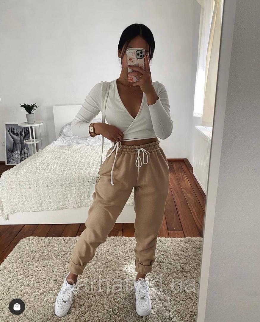 Теплые женские брюки бежевого цвета