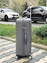 Чемодан из ударопрочного полипропилена пластиковый большого размера серого цвета., фото 2