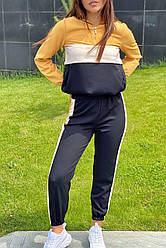 Женский трендовый спортивный костюм. Худи и джогеры. Цвет желтый. Размер 36, 38, 42, 44