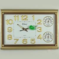 Круглые настенные часы с термометром и гигрометром (45х31х5 см)