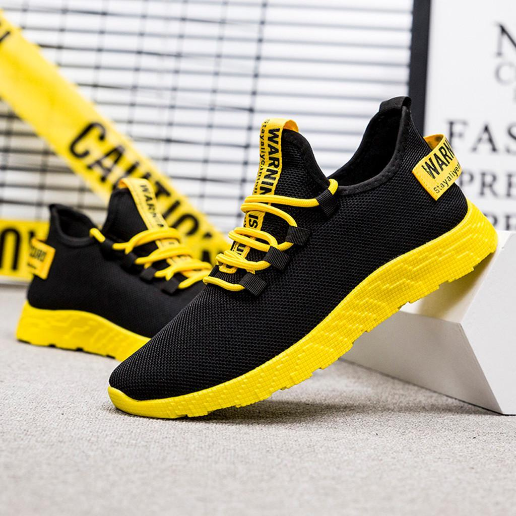 Удобные мужские кроссовки с желтой подошвой