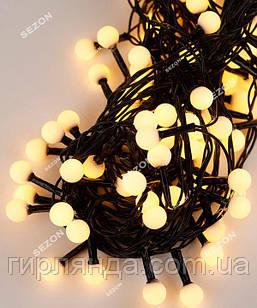 Кульки 10мм 100 LED 6м  чорний провід, білий теплий