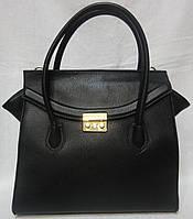 Модная сумка из кожзаменителя.