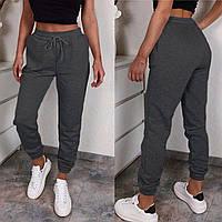 Теплые спортивные штаны женские