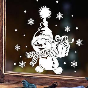 Новорічна наліпка на вікно, вітрину, стіну Сніговик з подарунком