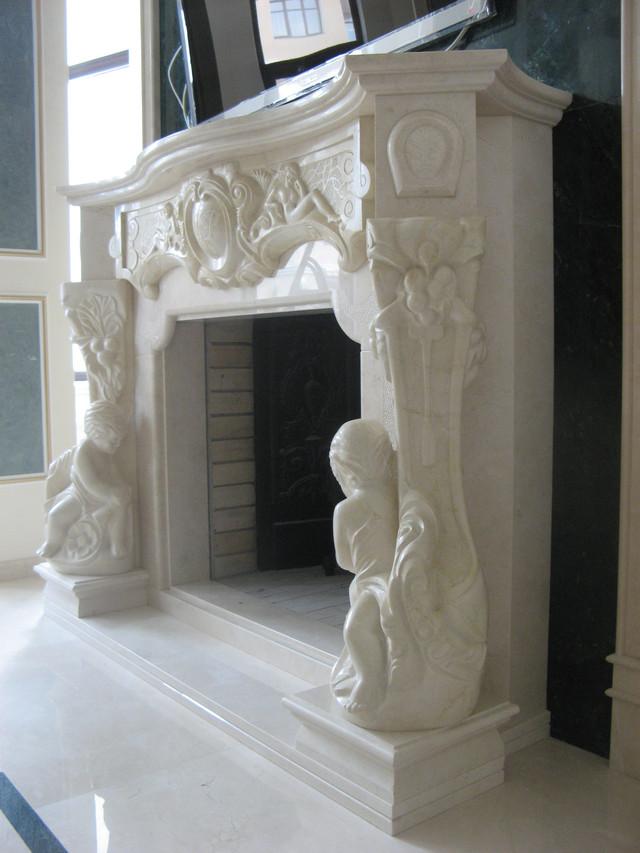 камин из мрамора с резьбой