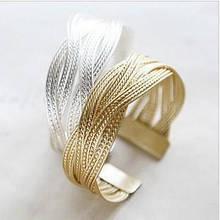 Плетений металевий браслет золотий