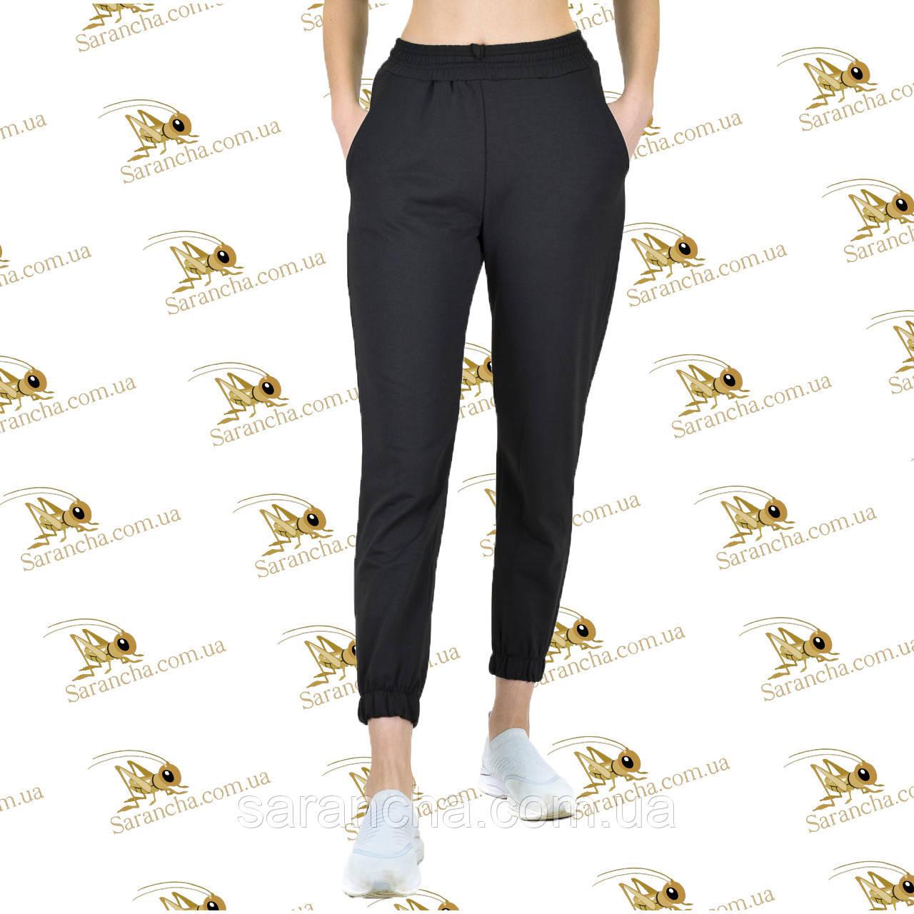 Утеплені жіночі брюки на манжеті чорна трехнитка на флісі