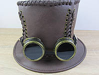 Цилиндр и очки в стиле стимпанк.