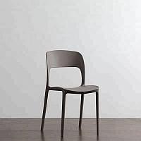 Черный пластиковый стул Ostin для баров, кафе, ресторанов, стильных квартир зеленый