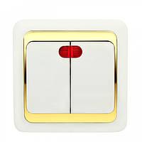 Выключатель Wega двойной с подсветкой золото