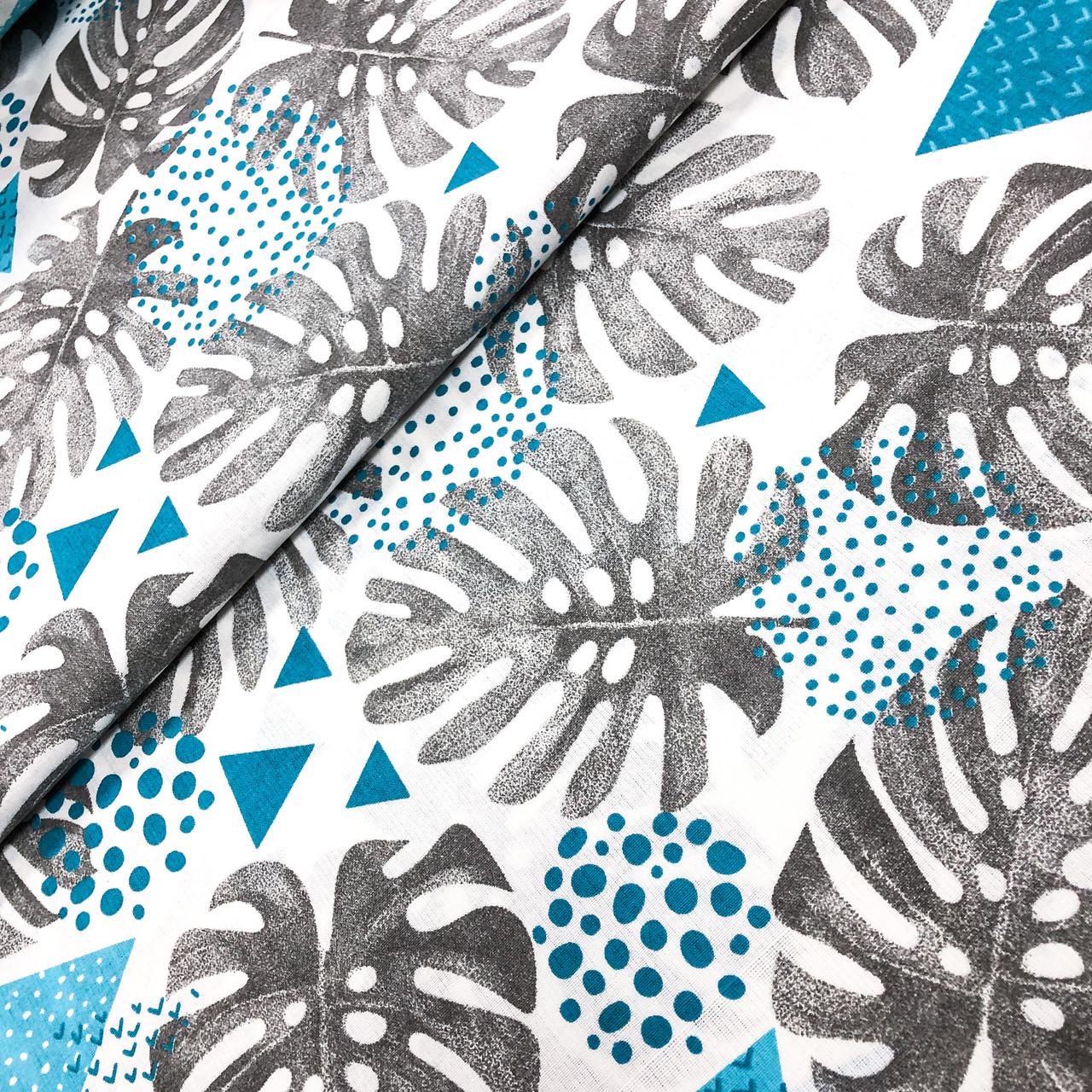 """Польская хлопковая ткань """"Голубые листья монстеры с геометрическими узорами"""""""