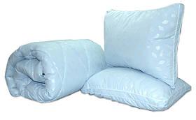 Ковдра полуторна блакитного кольору з наповнювачем штучний лебединий пух + 2 подушки 50х70 см