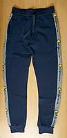 Утепленные трикотажные спортивные штаны для мальчика подростка на зиму
