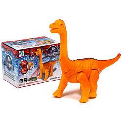 Динозавр в коробці на батарейках