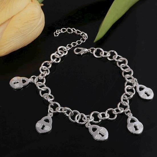 Посріблений стильний браслет з підвісками замок в сріблі
