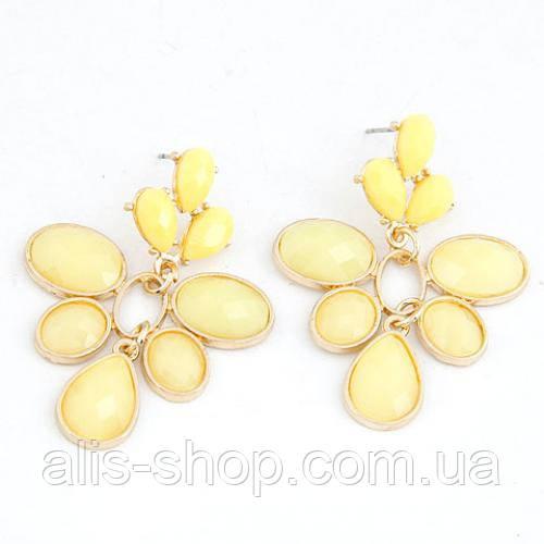 Яркие летные серьги гвоздики с крупными лимонными камнями