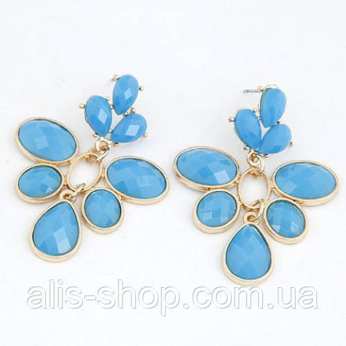 Яркие летные серьги гвоздики с крупными голубыми камнями