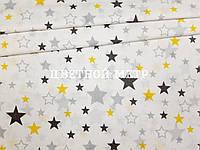 Ткань польский хлопок польская звезды серые и желтые большие и маленькие на белом
