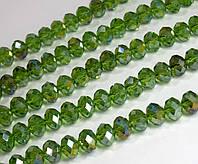 Кришталеві намистини (Рондель) 8х6мм пачка - приблизно 65-70шт, лісовий зелений прозорий з АБ