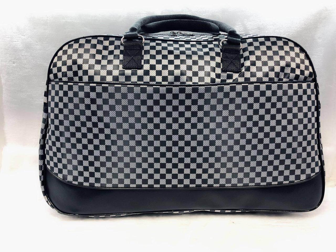 Жіноча дорожня сумка в клітку