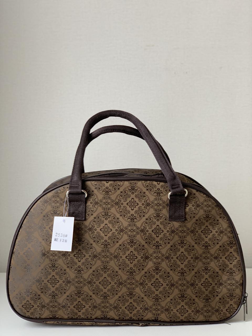 Коричнева жіноча дорожня сумка саквояж текстильна з ручками і плечовим ременем