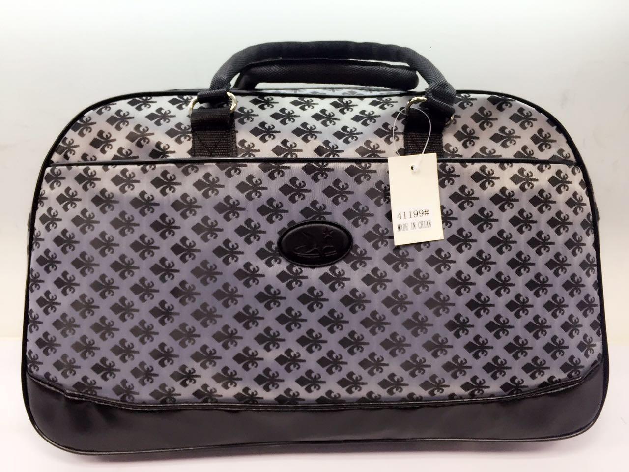 Стильна жіноча дорожня сумка-саквояж з текстилю
