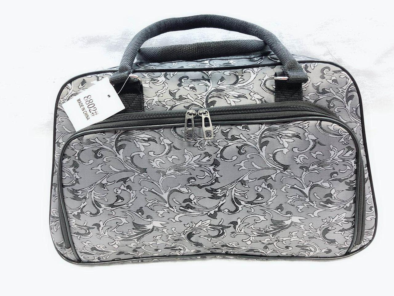 Непромокаємий текстильна жіноча дорожня сумка-саквояж мала сірого кольору