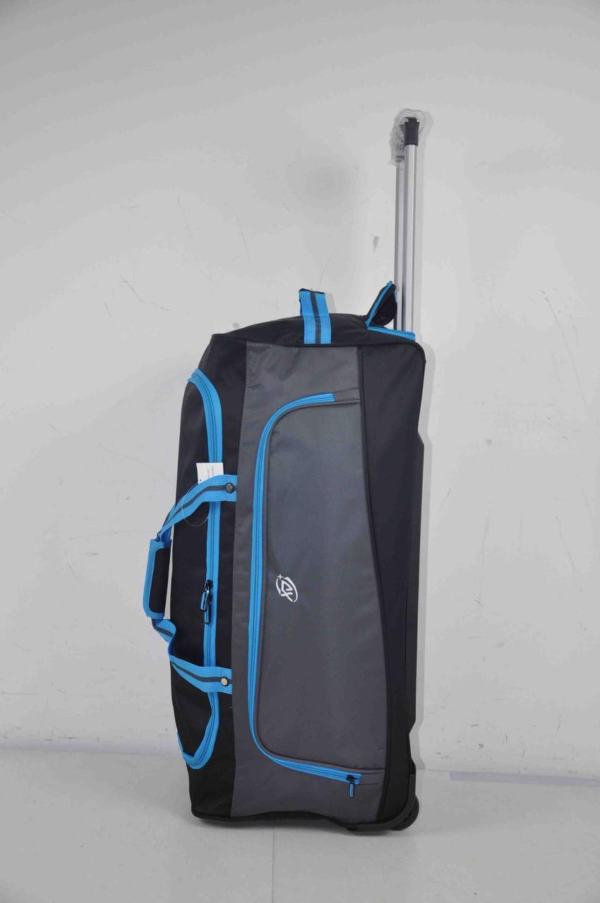 Дорожня сумка на колесах велика надійна з висувною ручкою