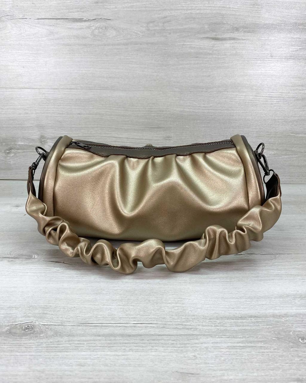 Маленькая стильная золотистая женская сумочка