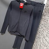Серый женский спортивный костюм Nike с прямыми брюками