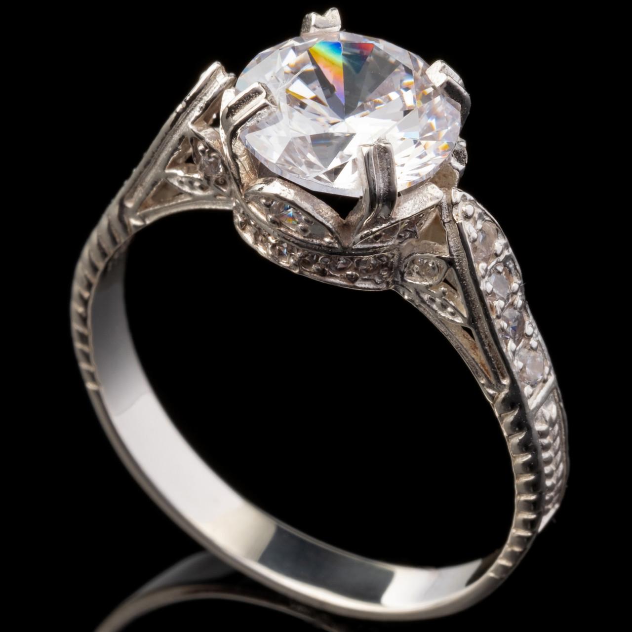 Серебряное кольцо 925 пробы с фианитами арт. 644к